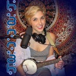 Hannah Etchison of Low La La, a unique Reno NV duo, holding a banjolele and smiling with her sweater off one shoulder