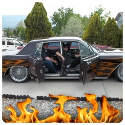 Abandon Minds in a car with suicide doors and flames painted on it all around in a classic style