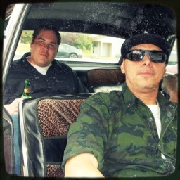 Will Imnot and Handsome Greg sitting in the car with leapoard seat covers