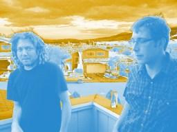 Dustin and Jon on a balcony over the Reno skyline