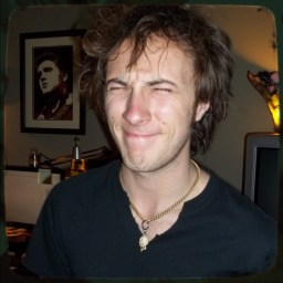Carter Stellon, drummer for KARMA, squinting his eyes.
