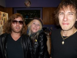 Greg Gilmore, Michelle Belle and Carter Stellon of KARMA, a Reno NV Rock band, with goofy smiles