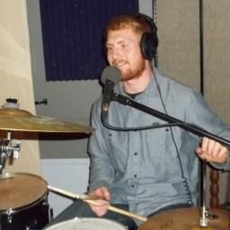 Corbin Cliften behind his drum set.