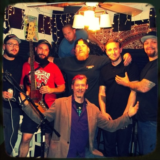 Reno Nevada band Down and Out is pictured in full getting silly with Worst Little Podcast host Rory Dowd.