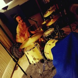 Nick Ramirez of Reno band One Ton Dually playing drums while recording the Worst Little Podcast.