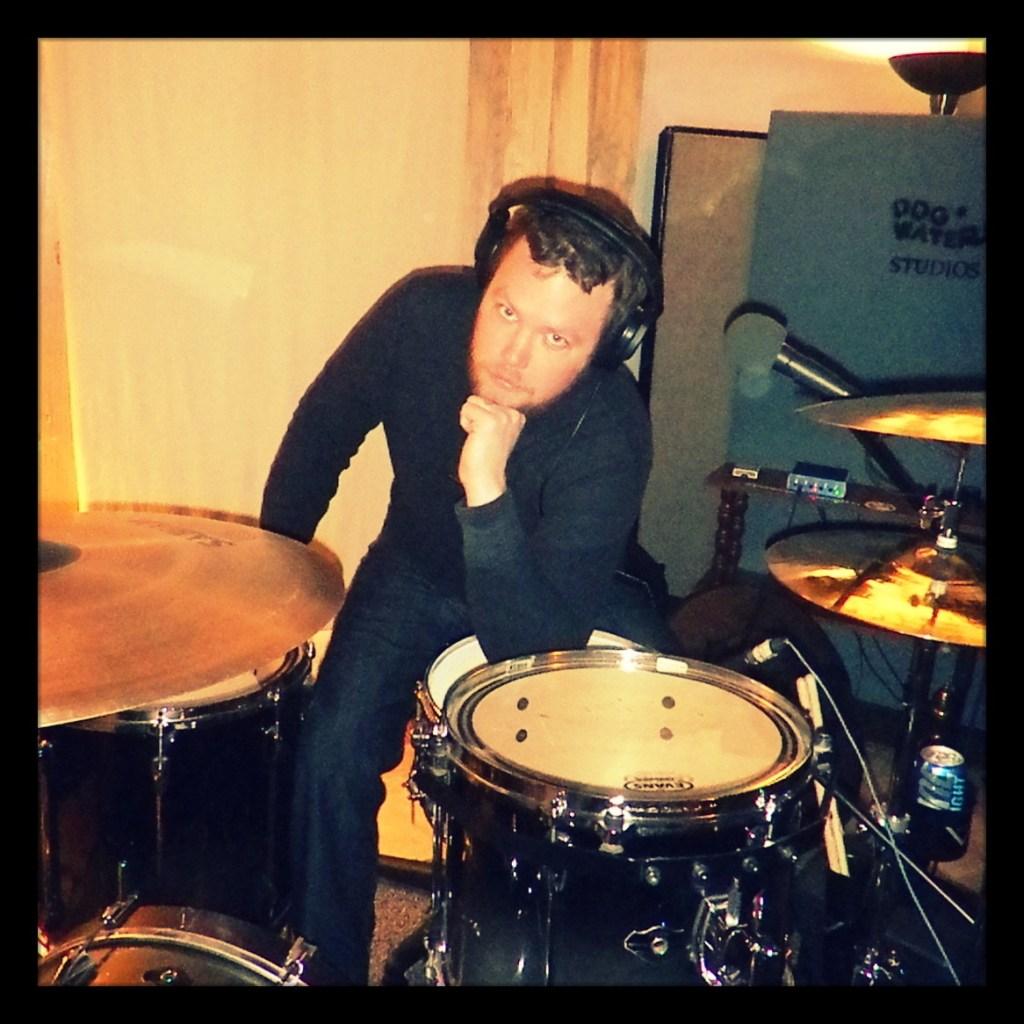 Garett, drummer for Reno metal band Kanawha posing with his set at Dogwater Studios.