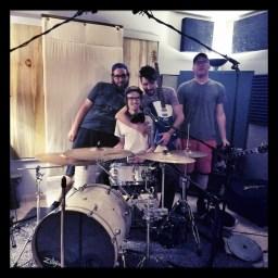 The members of reno band Heterophobia posing behind the drum kit.