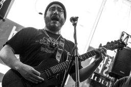 Wolfman Grimedog, playing guitar and singing