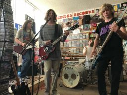 Reno band Erin Drive photographed playing their instuments at Recycled Records.