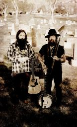 Josiah Knight and Olaf Vali Duna of Reno folk band Outlaw Kindred posing with their instruments.