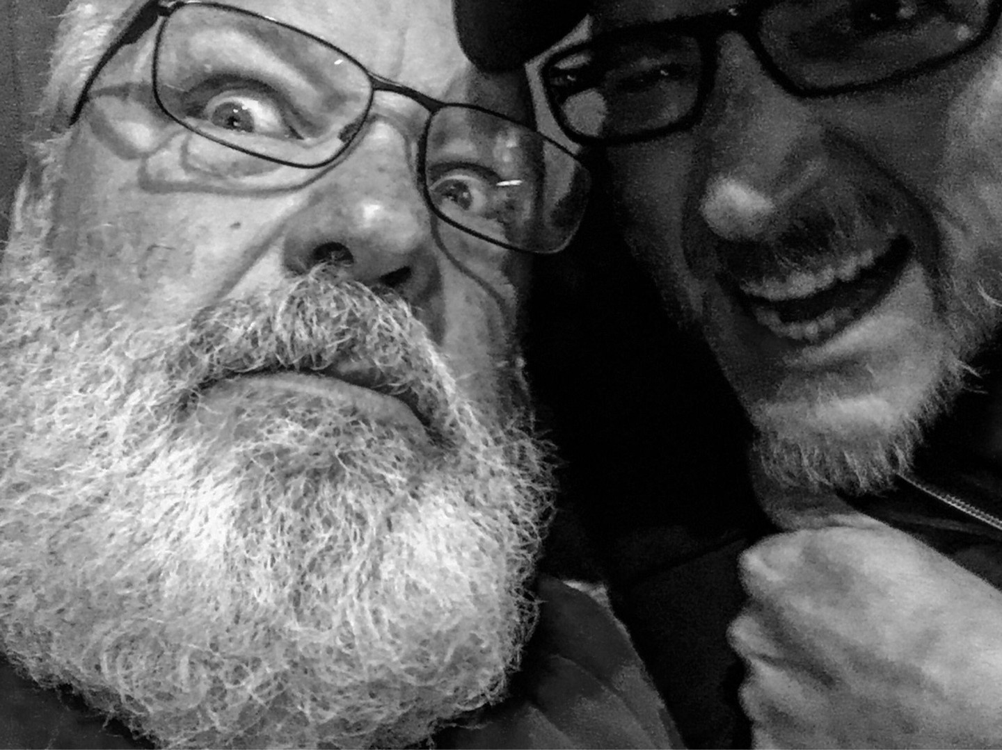 a closeup of Kyle Gass and Nick Ramirez in black and white