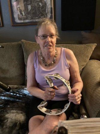 Cassie Funk holding a tamborine