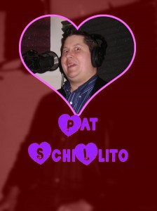 Pat Schillito with a heart shaped cutour around his face, making a stupid face