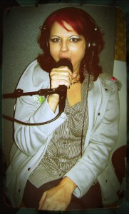 Comedian Jenny PezDeSpencer trying to swallow a microphone on The Worst Little Podcast 2012 01 21
