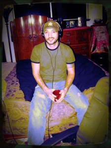 New Intern John Frederick sitting on the bed in Rick's bedroom/studio at Dogwater Studios 2013 01 21