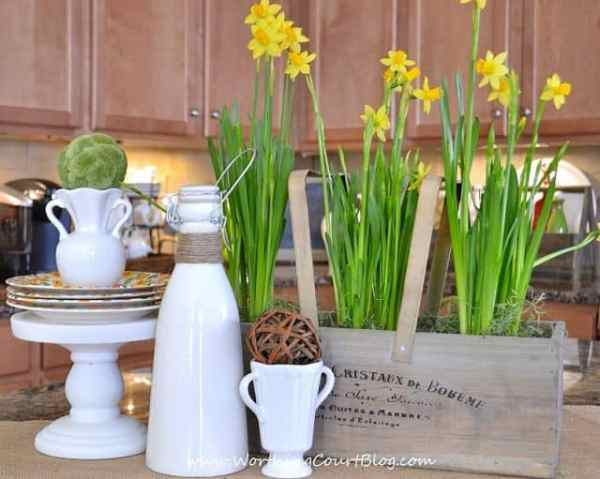Easy and cheery 5 minute Spring vignette on a kitchen island with daffodils and other natural elements.