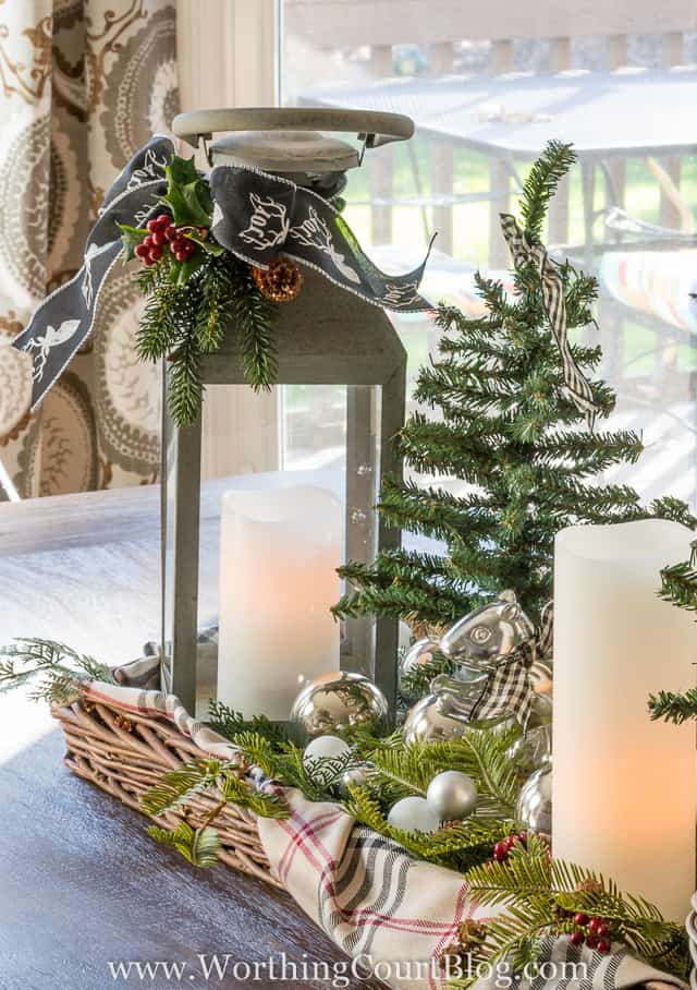 Decorating With Lanterns   Worthing Court How To Decorate With Lanterns   tie a sprig of faux greenery and pinecones  with pretty