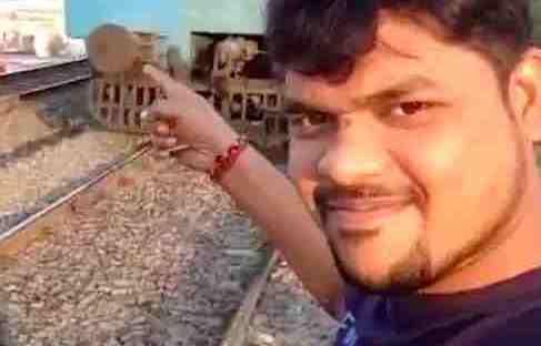 student pulls selfie train