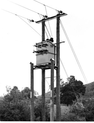 SWEHS 18.1.042.jpg - Date c1930s - 'H' type overhead line terminal pole with fuses and cable termination box. Devon, Torquay .