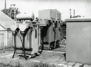 SWEHS 7.1.057.jpg - Date 1946 - Tolgus booster, English Electric Co., 1750kVA. Survived until Redruth 33/11kV network took over in 1950's. Note cable with LV supply and CT wiring. Cornwall, Redruth, Tolgus .