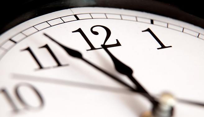 Closeup of hands on clock face_555962