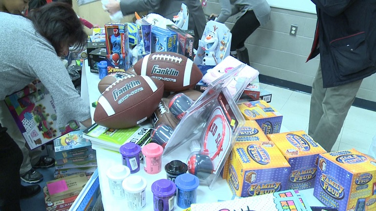 central-falls-kids-cops-christmas-toys-handing-out_1544561646029.JPG
