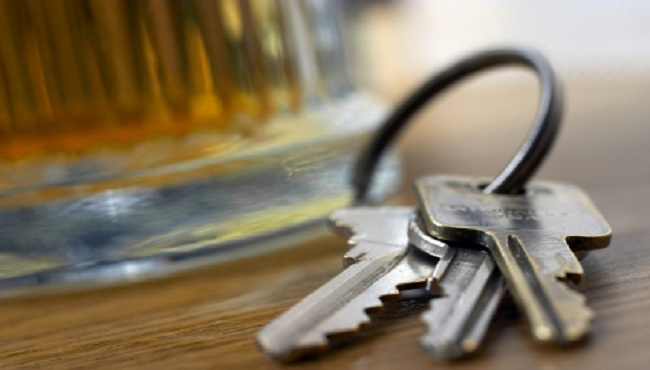 Drunk driving drinking beer keys