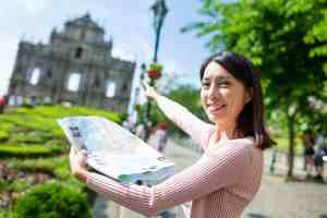 Woman holding city map in Macau city