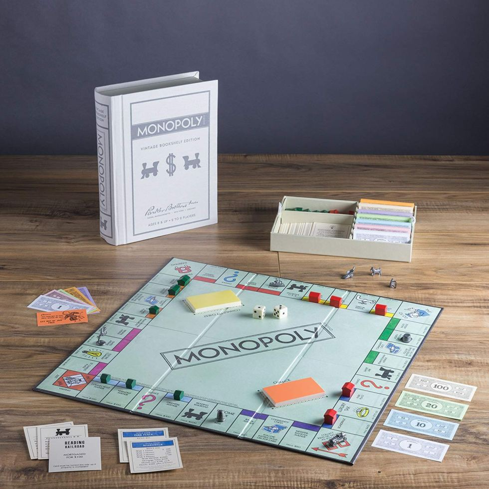 Vintage Monopoly set in a book