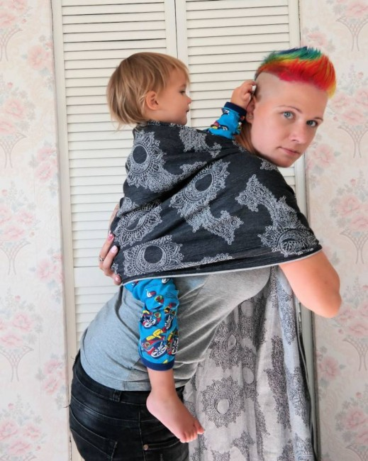 put your child on your back (always secure with one hand!)