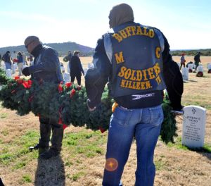 Bryan Correira | Herald Members of the motorcycle club, Buffalo Soldiers, help remove wreaths from the Central Texas State Veterans Cemetery on Sunday, Jan. 5, 2014.