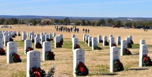 Bryan Correira | Herald Volunteers walk across the field at the Central Texas State Veterans Cemetery on Sunday, Jan. 5, 2014. More than 5,000 wreaths were to be removed.
