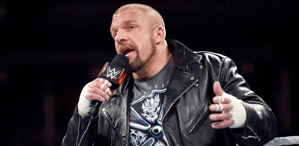 Triple H bodyslams Jimmy Fallon through his desk during The Tonight Show