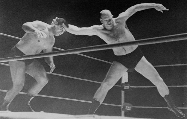 Fritz Von Erich prepares to throw Buddy Marino to the mat in their match