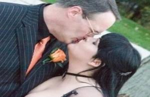 Jim Cornette kissing wife