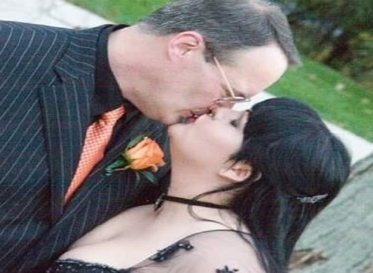 Jim Cornette kissing wife