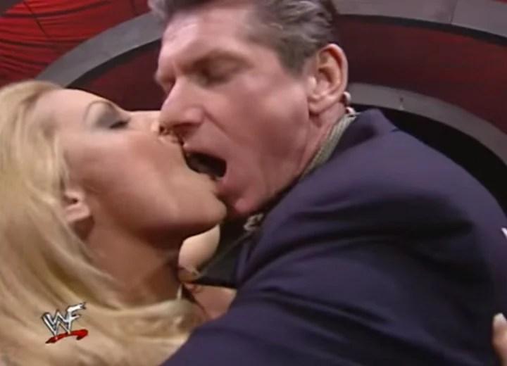 Vince McMahon kissing Trish Stratus