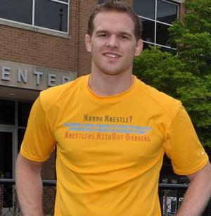 Hudson Taylor in a yellow 'wanna wrestle' shirt