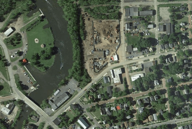 An Ariel view showing the Weitsman Scrap Metal business and its close proximity to residential housing as well as the Chadakoin River. The Outlet Ave. paper street runs along the western edge of the business's property, next to the Chadakoin River. (Image from Google Maps)