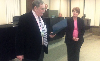Chautauqua County Legislature Chairman Jay Gould reads a commendation as Jamestown legislator Paula DeJoy looks on. DeJoy announced Wednesday night that she would be resigning from the panel because she'll be moving out of District 11 in Jamestown.