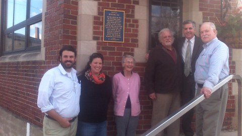 Members of Hope's Steel Windows & Doors stand with city officials under the new historical marker that was recently placed outside the company's administrative office entrance on Hopkins Ave. in the city.