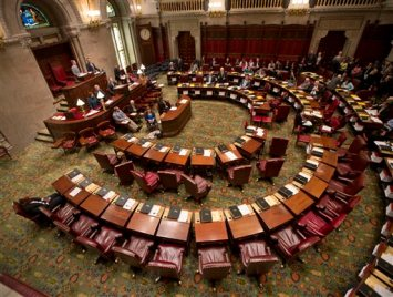 Chairs are empty on the Democratic side of the Senate Chamber after Democratic senators walked out of session at the Capitol on Wednesday, May 6, 2015, in Albany, N.Y. Democratic lawmakers walked out of the Senate in protest Wednesday after Republicans refused to allow the vote to remove Dean Skelos as Senate majority leader. (AP Photo/Mike Groll)
