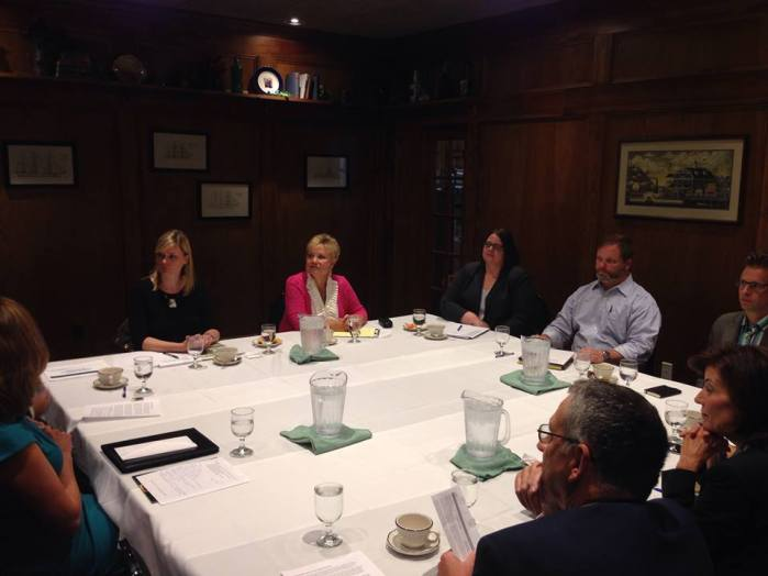 Lt Gov. Kathy Hochul (lower right) listens in during a roundtable discussion on tourism and economic development in Chautauqua County at Webb's Captain's Table in Mayville, NY on Thursday, July 23.