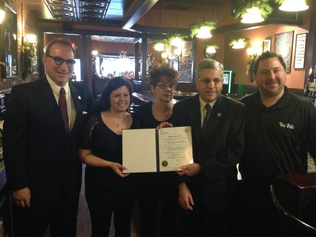 Pictured, from left, are: Vince DeJoy, Jamestown's development director; Melissa Williamson, an employee of The Pub; Mary McCusker, owner of The Pub; Sam Teresi, Jamestown mayor; and Sam Lisciandro, manager of The Pub.