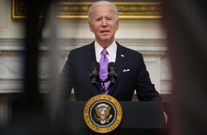 Biden signs 10 virus orders, requires masks for travel