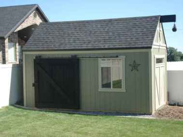 green shed with sliding door