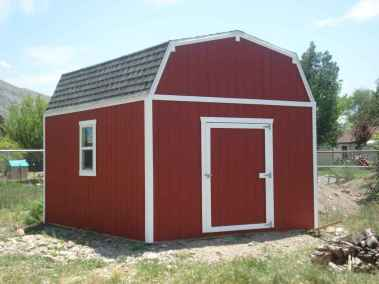 red and white farm style shed