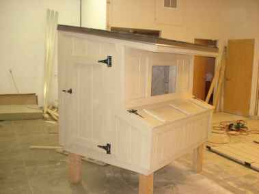tan and white chicken coop