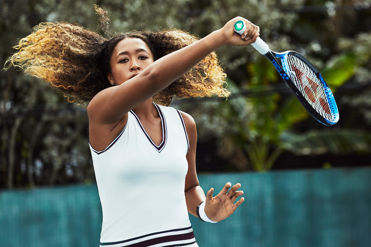 Boca Raton, FL- Jan 31, 2019 : Naomi Osaka Photographed at the Evert Tennis Academy.  Credit: Williams & Hirakawa for ESPN Hair Lennie Billy/Artists at Wilhelmina   Makeup Nina Alcantara /Artists at Wilhelmina  Wardrobe Stylist Erika Golcher  Wardrobe: V Neck Tennis Dress by Tory Sport; Sneakers by Cole Haan; Star earrings by H. Stern;  Eco-Drive Bluetooth Watch by Citizen  Location: Evert Tennis Academy