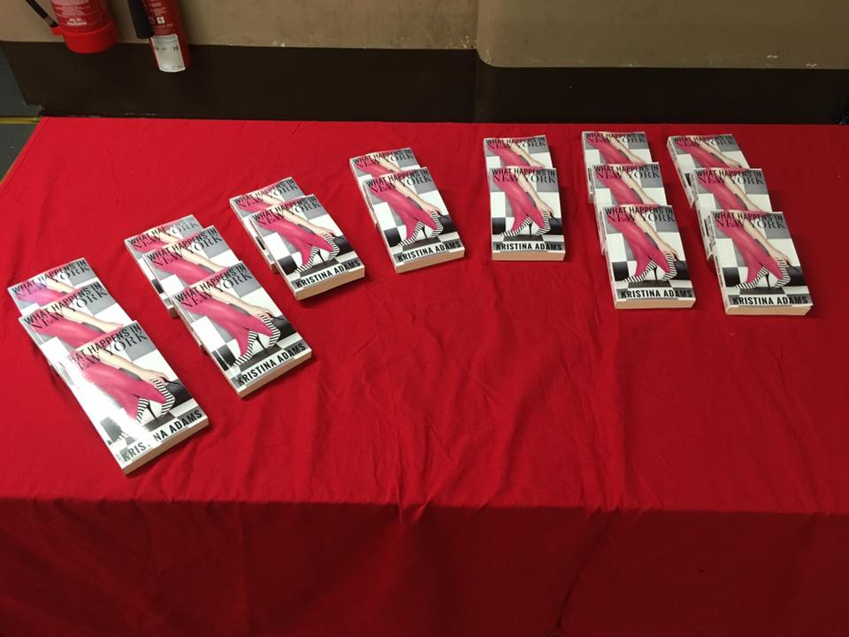 Books lined up at the launch for What Happens in New York!
